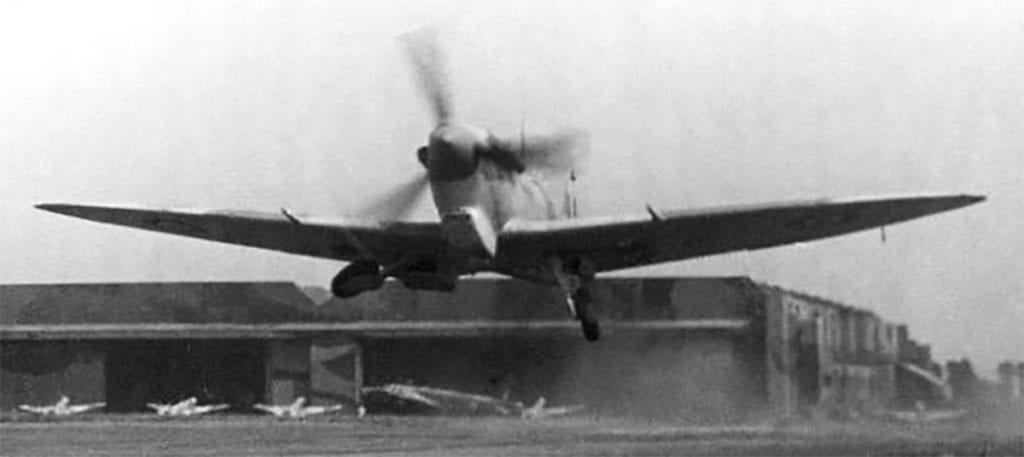 Alex getting airborne from the apron on another test flight from Castle Bromwich in a Spitfire Vb fitted with a Vokes tropical filter.