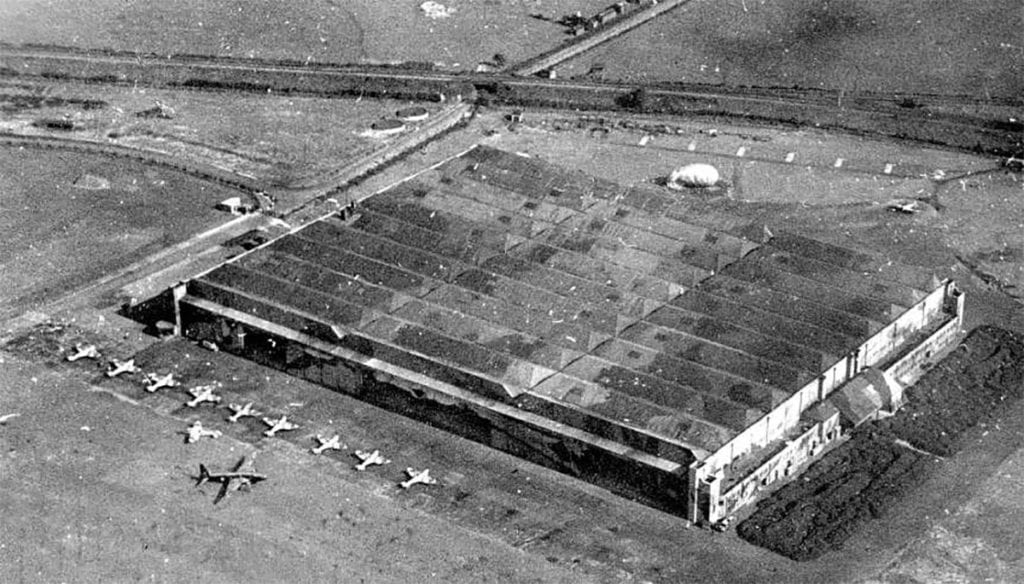 The flight test sheds at Castle Bromwich with Spitfires standing ready for flight. A repaired Wellington may also be seen.